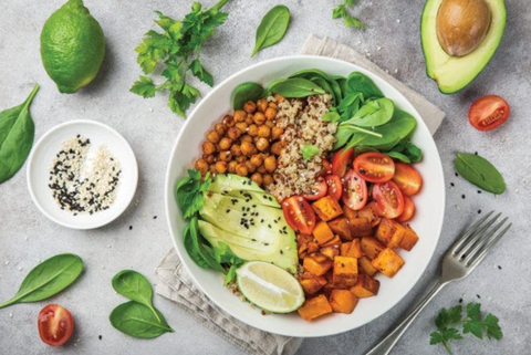 Healthy plant-based plate with tomato, avocado, chickpea, rice, spinach