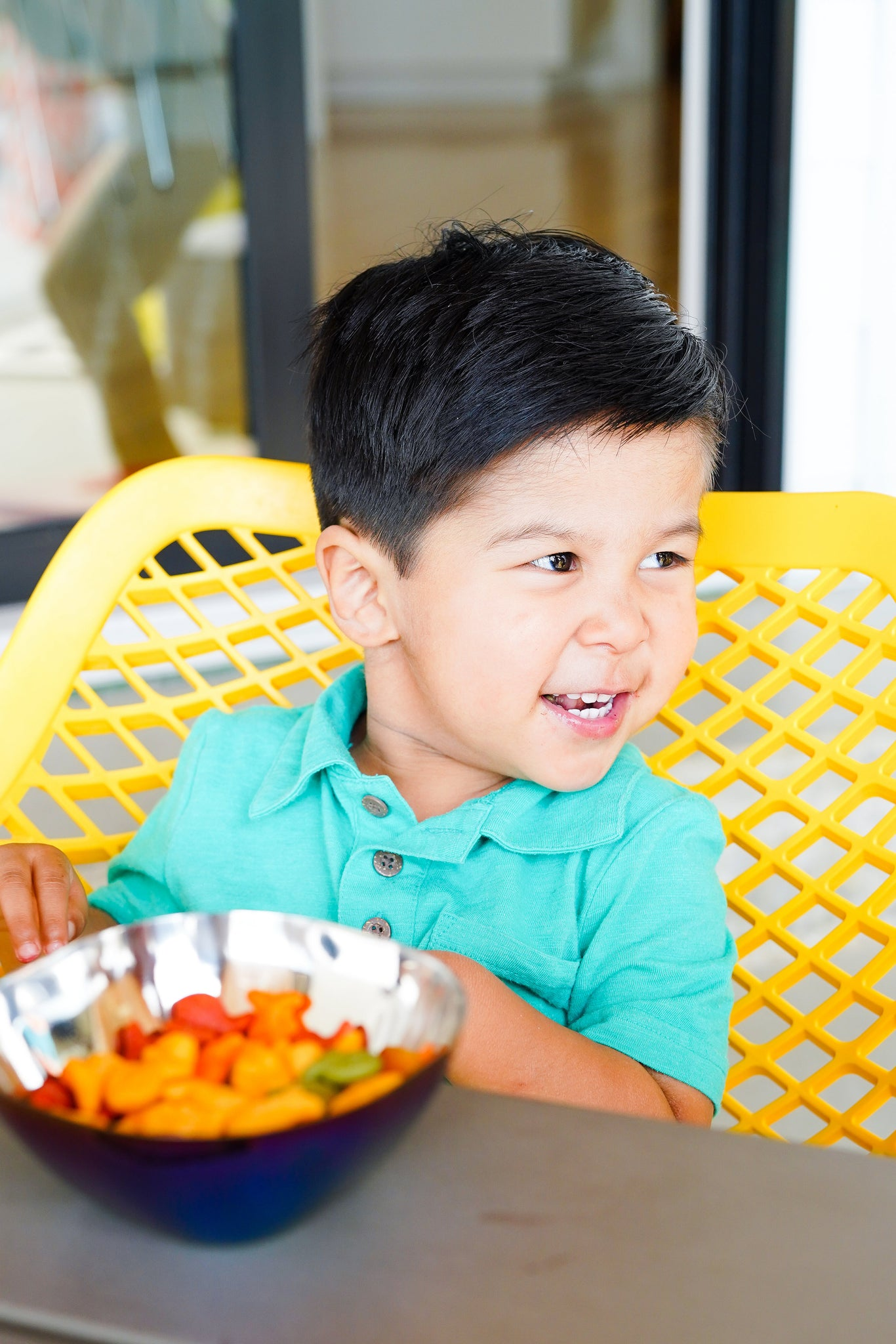 Child using blue stainless steel bowls, non-toxic, plastic-free, 100% metal, no chipping or peeling