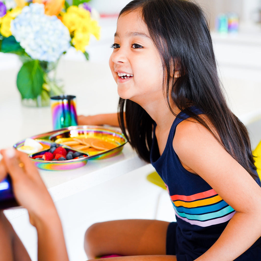 Rainbow plate with healthy foods for kids