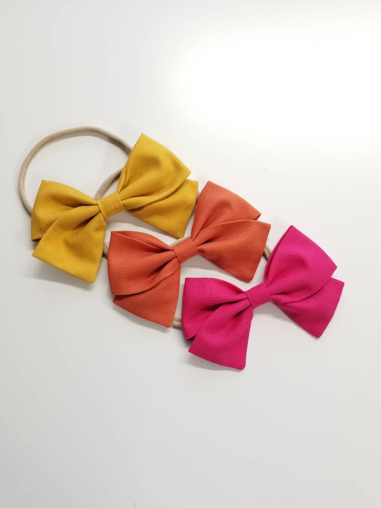 Baby bows Handmade / Must have set Mustard, Copper and Fuschia / Nylon Headbands or Hair Clips