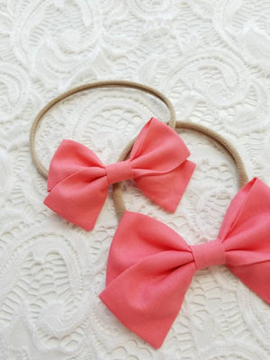 Baby bow, hot coral, Handmade baby Bows, Nylon Headband or Hair Clip, baby headbands, hair clips.