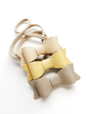 Baby bows, baby headbands, Genuine Leather Mini Bows, set of 3 Handmade, nylon headband, mellow yellow, beige, Nude, neutral colors.