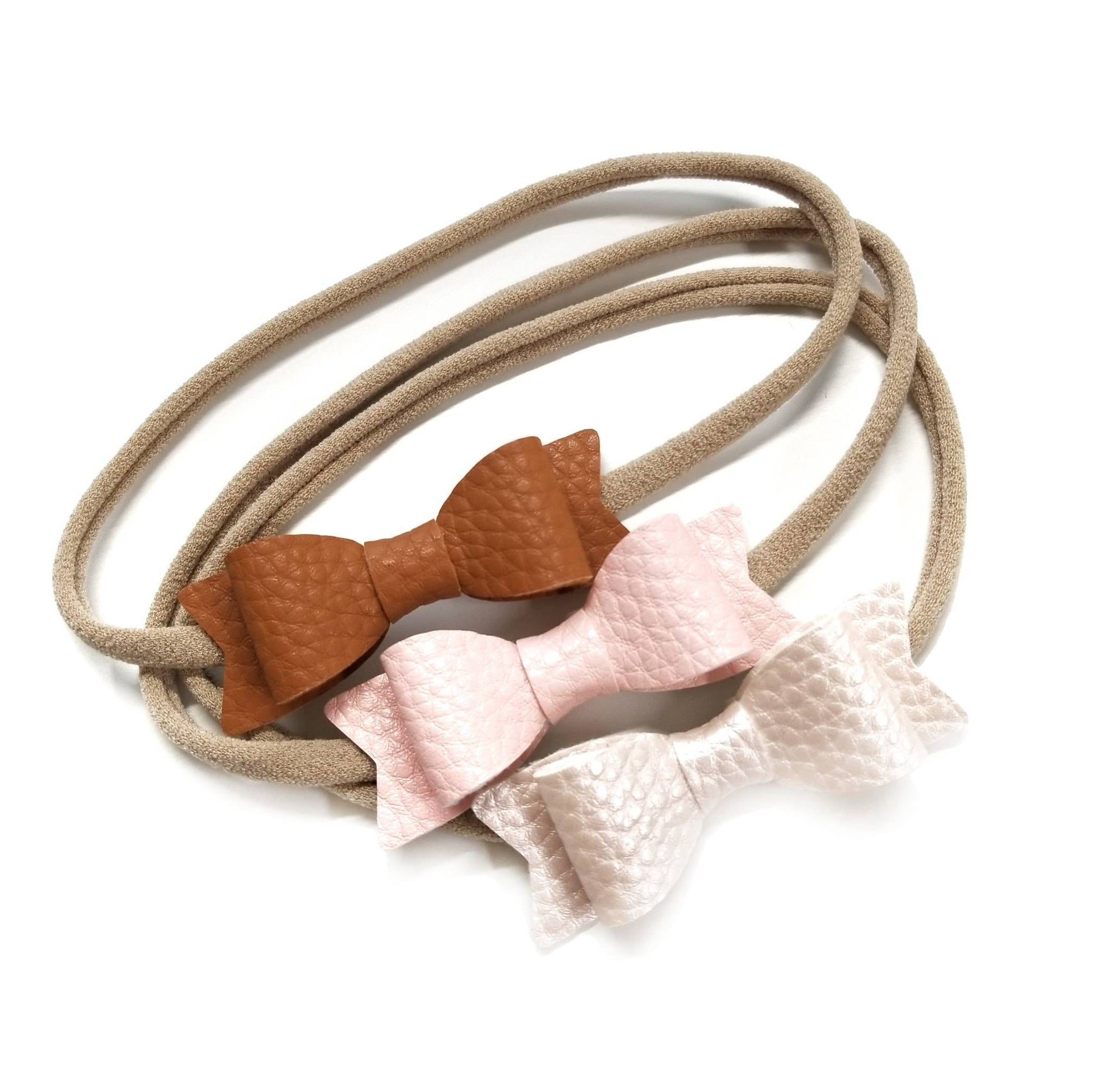 Baby bows, shades of blush, metallic shades, Leather headbands, baby headbands, vanaguelite, hair accessories, baby headbands.