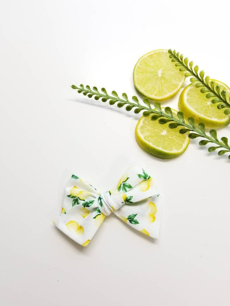 Baby Bows, watercolor lemons print, Nylon Headbands or Hair Clip
