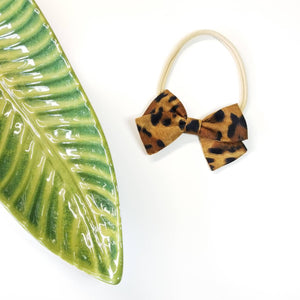 Baby bow, Leopard Print Bows, Handmade baby Bows, Nylon Headband or Hair Clip, baby hair accessories.