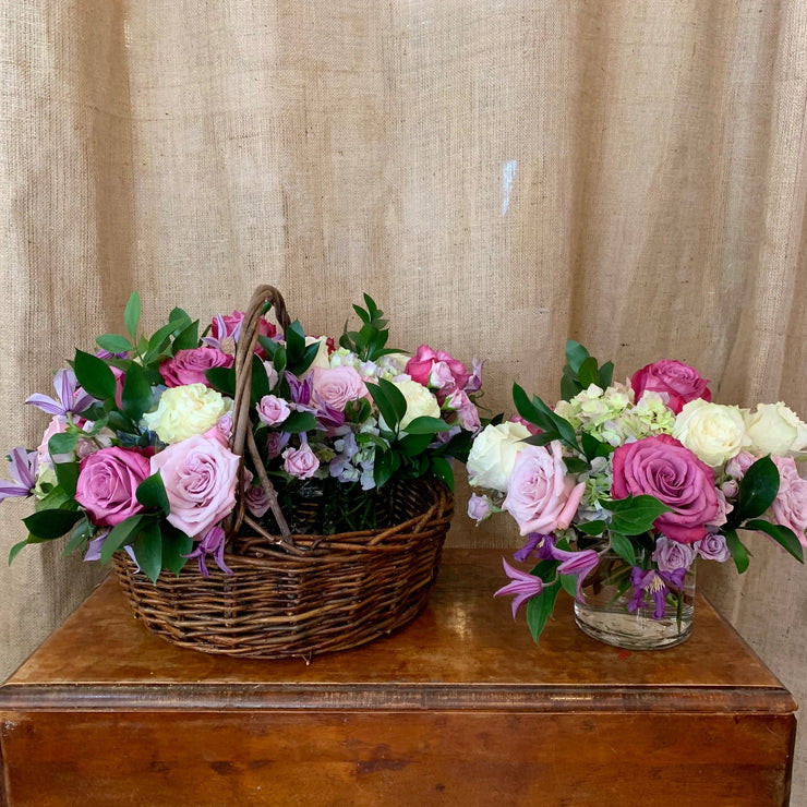 4 vase arrangements in a basket.