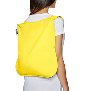 Notabag Original in yellow backback
