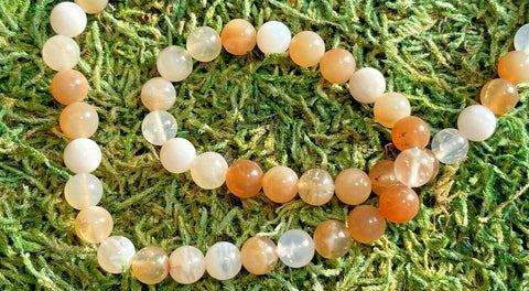 Perles en Opale orange en 8 mm