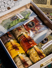Load image into Gallery viewer, Banu's starter kit box filled with spices.