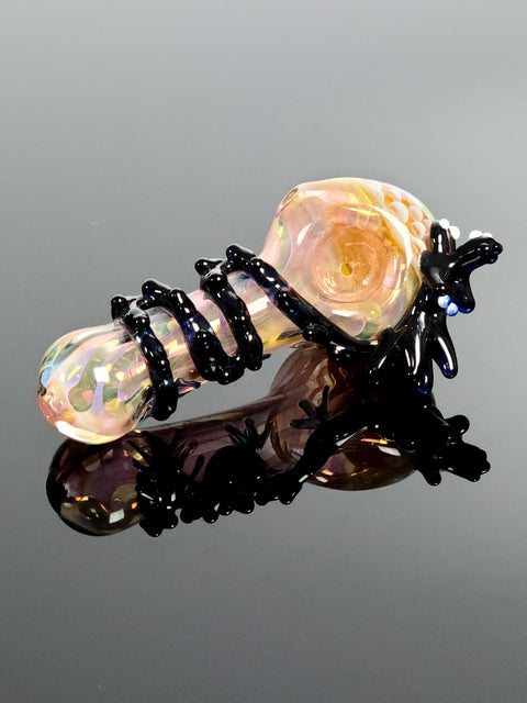 Pink glass spoon with black dragon with blown in puffs