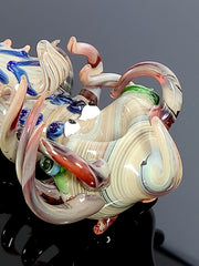 Creature pipe with swirls and tentacles