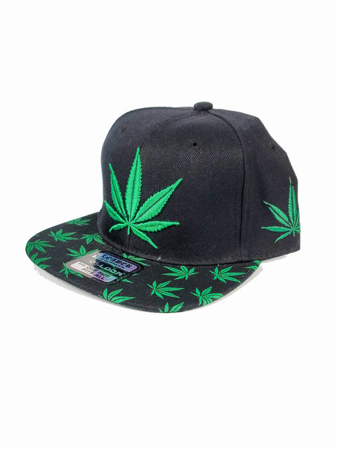 Black snapback with green canna leaf and on bill