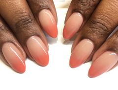 nude to coral pink ombre nail art. a nude nail color for dark skin