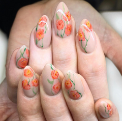a nude nail color with orange spring time watercolor flower nail art