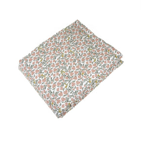 Garbo&Friends filled blanket with a floral vine pattern