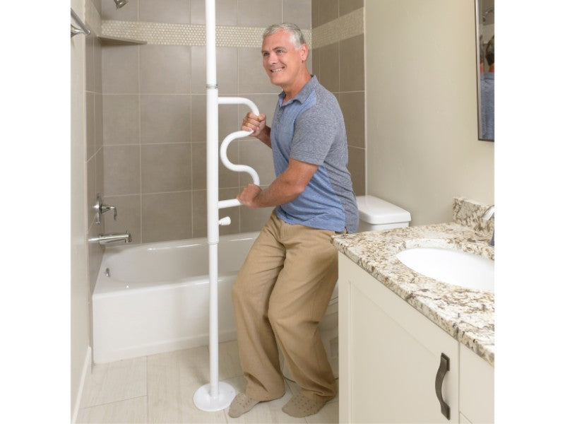 Standing man grabbing the white Stander Security Pole & Curve Grab Bar