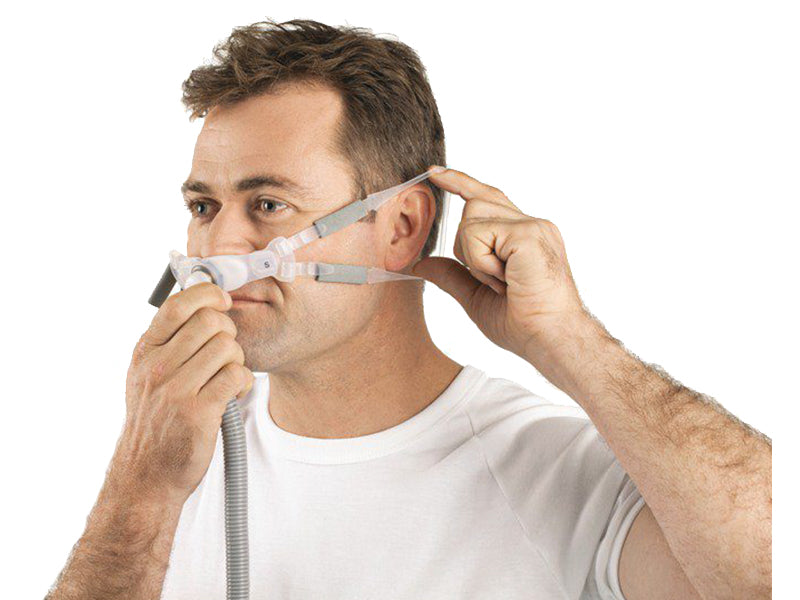 Man adjusting the loops of ResMed Swift FX Bella Gray Nasal Pillows CPAP Mask