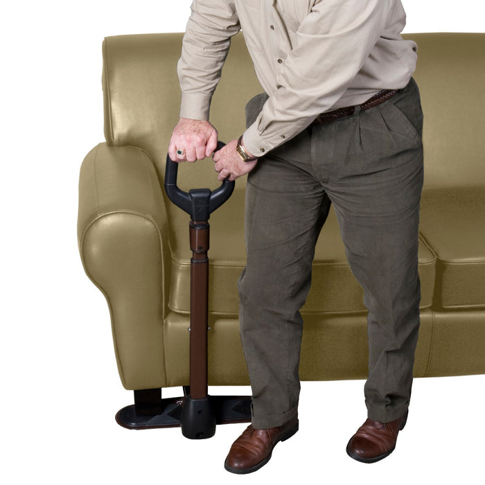 Man leaning on the Stander CouchCane with Organizer Pouch