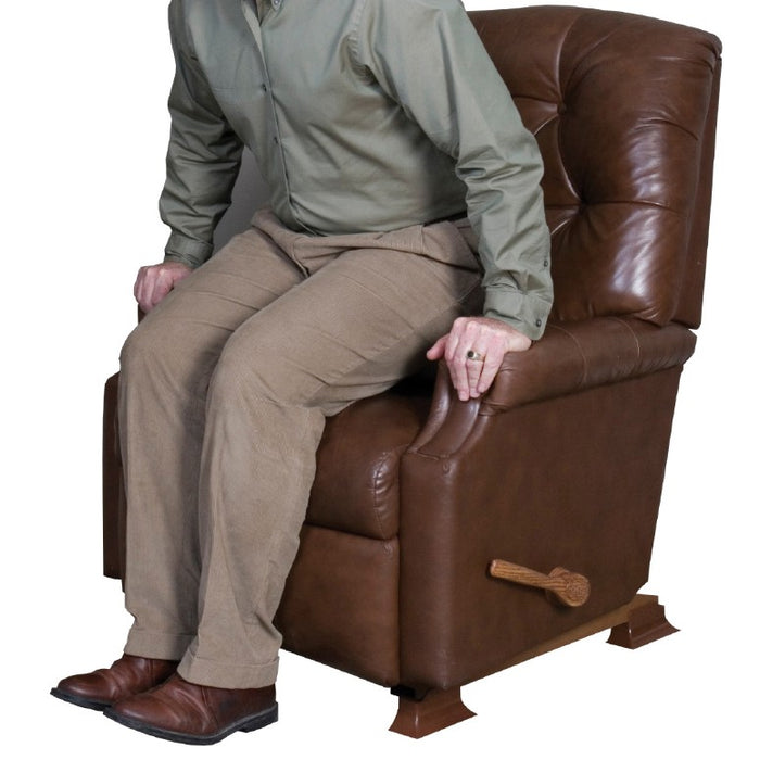 Man sitting on sofa with Stander Furniture Riser