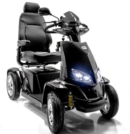 Merits Health S941L Silverado Extreme 4-Wheel Full Suspension Electric Scooter black, with headlights on