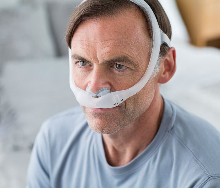 Philips Respironics DreamWear Gel Pillows CPAP mask worn by a man