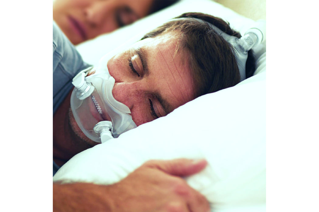 Philips Respironics DreamWear Full Face CPAP mask worn by a sleeping man