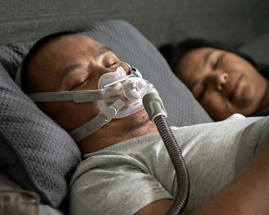 ResMed AirFit F30 Full Face CPAP Mask worn by sleeping man