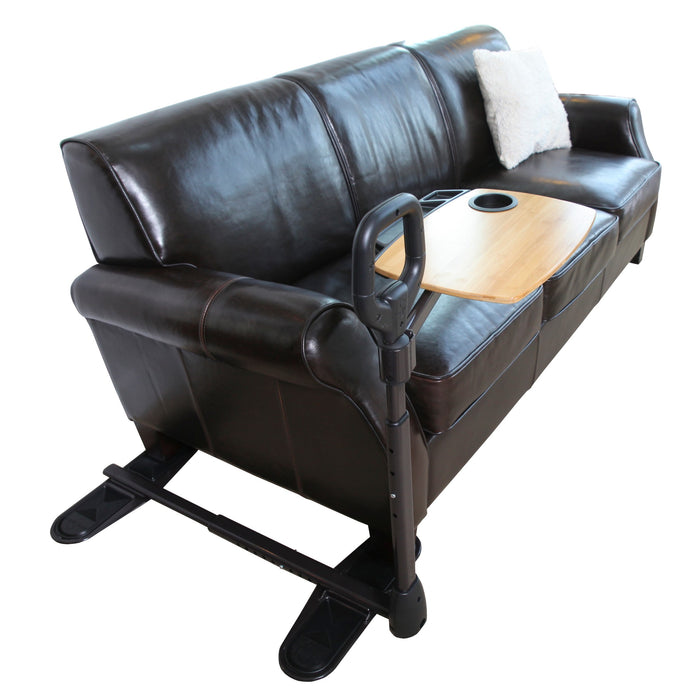 Stander Assist-a-Tray installed next to a long black couch