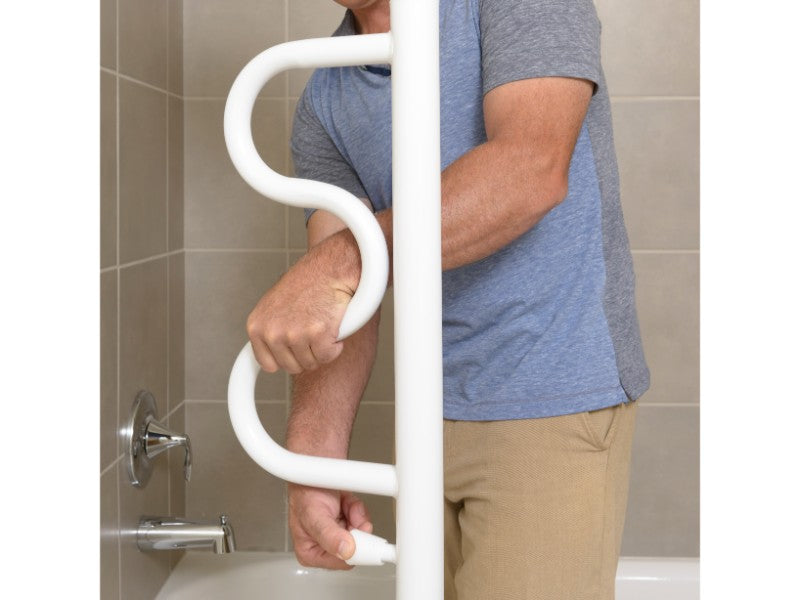 Man grabbing the white Stander Security Pole & Curve Grab Bar