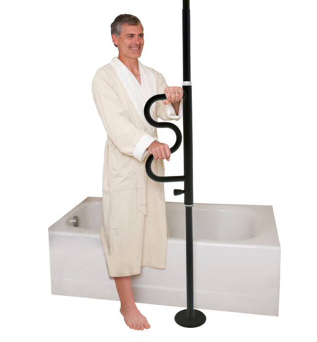 Standing man in bathrobe holding onto the black Stander Security Pole & Curve Grab Bar