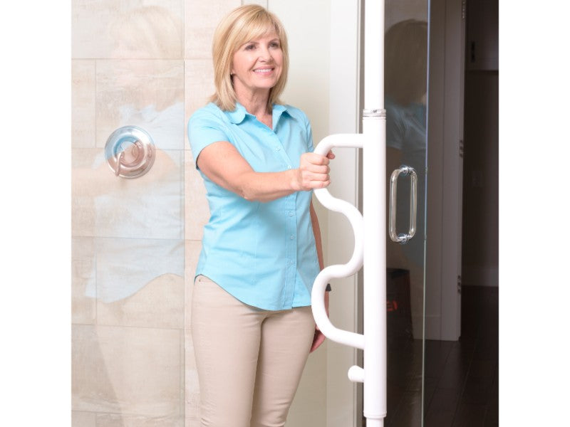 Woman holding onto the white Stander Security Pole & Curve Grab Bar