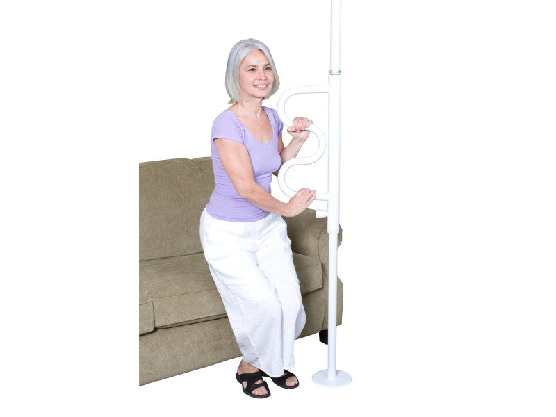 Elderly woman holding onto the white Stander Security Pole & Curve Grab Bar