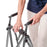 Woman assembling Stander EZ Fold-N-Go Walker Walnut Black