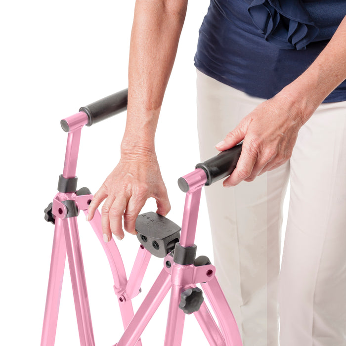 Woman assembling Stander EZ Fold-N-Go Walker Regal Rose