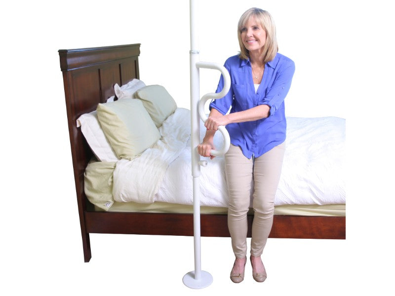 Standing woman grabbing the white Stander Security Pole & Curve Grab Bar