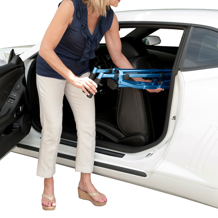 Woman putting Stander EZ Fold-N-Go Walker Cobalt Blue inside her car