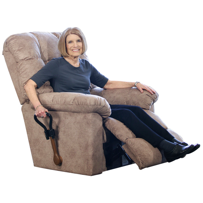 Woman sitting on couch while holding Stander Recliner Lever Extender