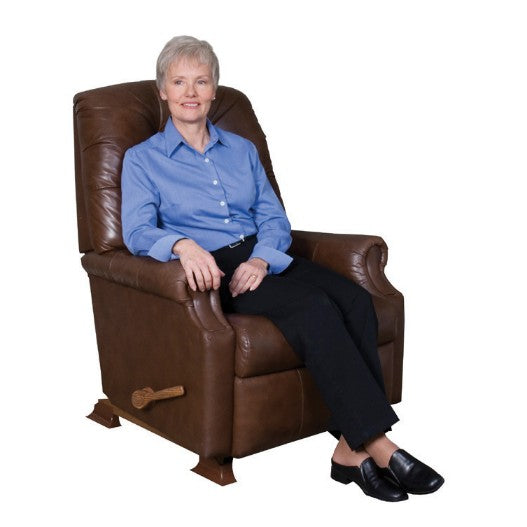 Woman sitting on sofa with Stander Furniture Riser