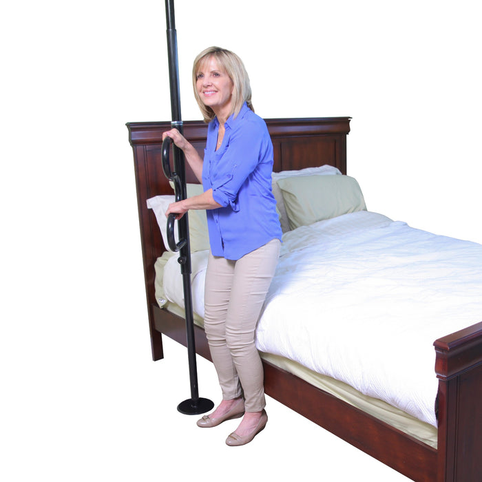 Standing woman grabbing the black Stander Security Pole & Curve Grab Bar