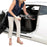 Woman putting Stander EZ Fold-N-Go Walker Walnut Black inside her car
