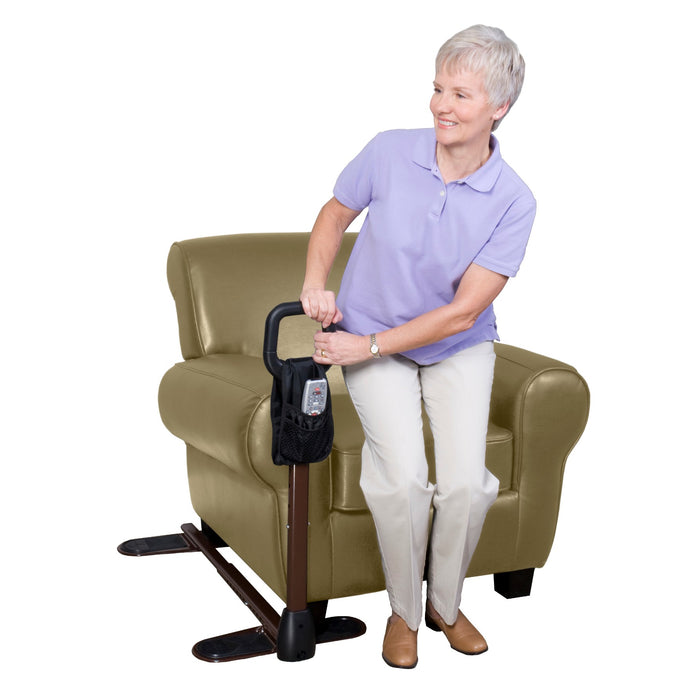 Woman leaning on the Stander CouchCane with Organizer Pouch