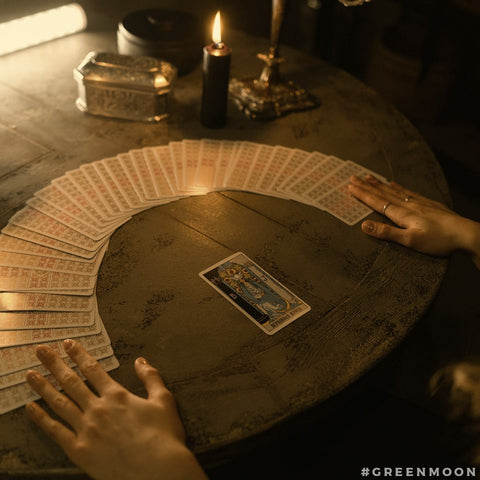 Tarot cards spread on a table, with the High Priestess displayed