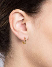 Miansai women's gold earrings available at our men's boutique in Middleton, Wisconsin.