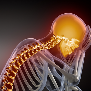 Photo of a skeleton sitting down resting its head in its hands and its elbows on its knees. The background is black, the skeleton is light grey and the spine and head are highlighted are highlighted gold.