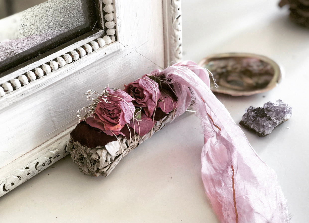 sage smudging stick with roses abalone shell and amethyst crystal