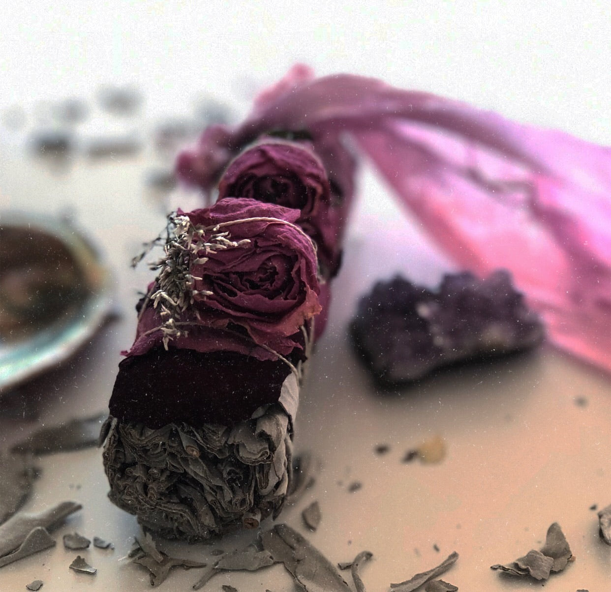 Sage smudge stick with roses and healing crystal