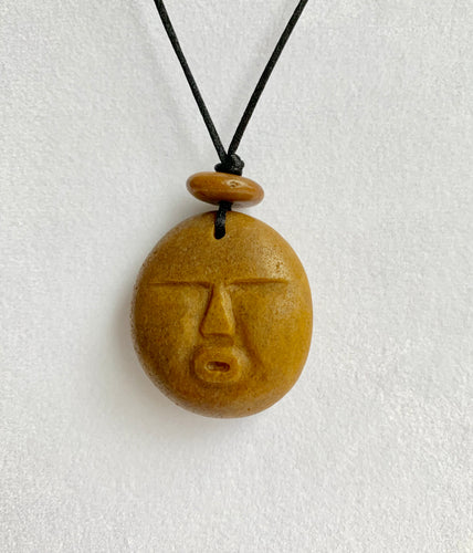 Beach Rock Carved Face necklace