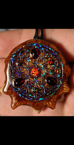 4 black opals with 3 garnet's over blackout flower of life