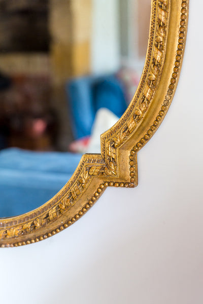 Antique French gilt gesso oval mirror closeup
