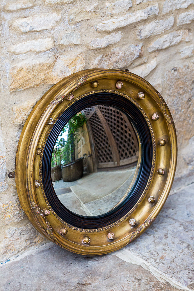 Offbeat Interiors - A Giltwood Convex Mirror